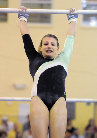 Niwot's Allie Koldway performs on the bars during competition at the Paul Derda Recreation Center in Broomfield on Tuesday.<br /> September 13, 2011<br /> staff photo/ David R. Jennings