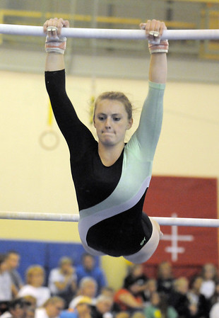 Niwot's Ariel Mosier performs on the bars during competition at the Paul Derda Recreation Center in Broomfield on Tuesday.<br /> September 13, 2011<br /> staff photo/ David R. Jennings