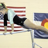 Niwot's Kayla Overfield performs on the bars during competition at the Paul Derda Recreation Center in Broomfield on Tuesday.<br /> September 13, 2011<br /> staff photo/ David R. Jennings