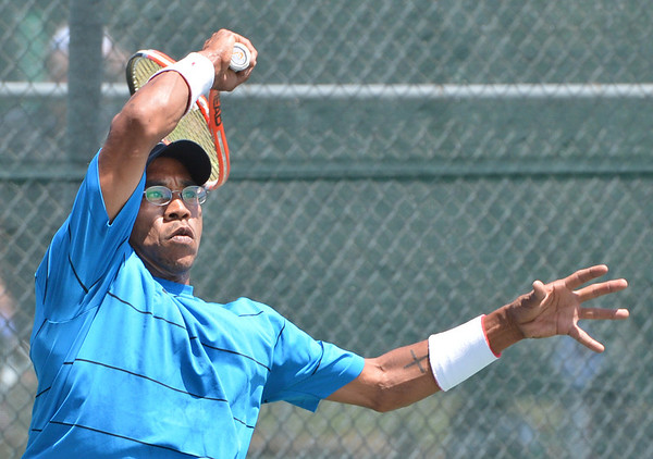 Paul Williams returns the ball to Brandon Lupo during the Men's Open Tennis Final at the Broomfield Swim and Tennis Club on Saturday.<br /> <br /> July 14, 2012<br /> staff photo/ David R. Jennings