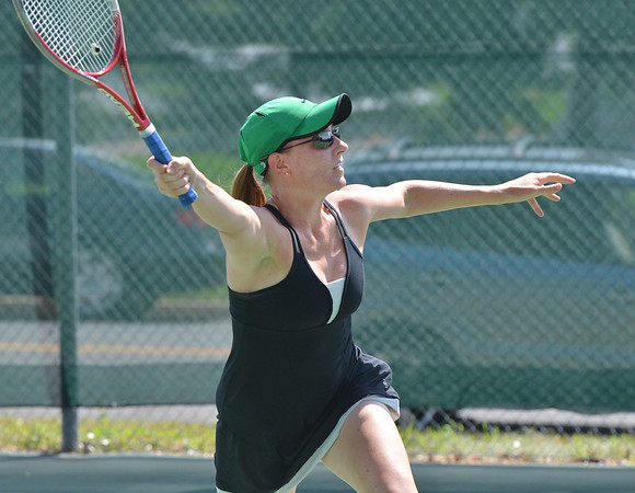 Laura Ewert  returns the ball to Stephanie Giltner during the Women's Open Tennis Final at the Broomfield Swim and Tennis Club on Saturday.<br /> July 14, 2012<br /> staff photo/ David R. Jennings