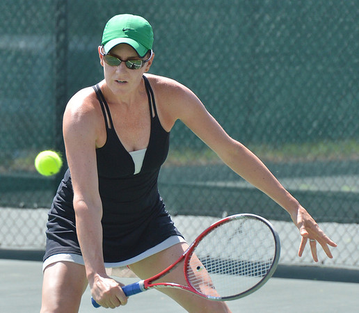 Laura Ewert  returns the ball to Stephanie Giltner during the Women's Open Tennis Final at the Broomfield Swim and Tennis Club on Saturday.<br /> <br /> July 14, 2012<br /> staff photo/ David R. Jennings