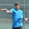 Paul Williams returns the ball to Brandon Lupo during the Men's Open Tennis Final at the Broomfield Swim and Tennis Club on Saturday.<br /> July 14, 2012<br /> staff photo/ David R. Jennings