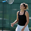 Stephanie Giltner tosses her racquet into the air after missing a return  to Laura Ewert during the Women's Open Tennis Final at the Broomfield Swim and Tennis Club on Saturday.<br /> <br /> July 14, 2012<br /> staff photo/ David R. Jennings