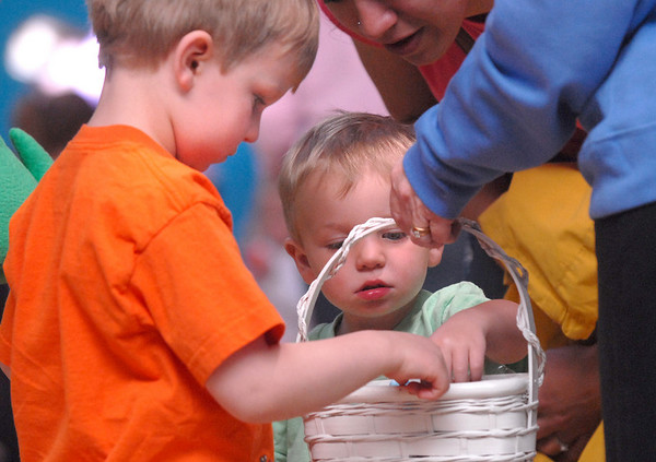 Quinn Taylor, 4, left, and his brother Will, 2, check out the candy  during the preschool Easter Party at the Broomfield Community Center on Thursday.<br /> <br /> April 21, 2011<br /> staff photo/David R. Jennings