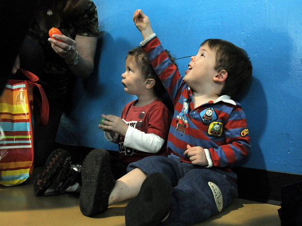 Christopher Nichols, 2, right, and Zann Singleton, 1, look at their candy during the preschool Easter Party at the Broomfield Community Center on Thursday.<br /> <br /> April 21, 2011<br /> staff photo/David R. Jennings