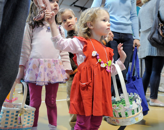 Alana Portillo, 2, center, with her sister Taylor, 4, and cousin Carson Richards, 4, watch Flopsy the Bunny while standing in line for pictures during the preschool Easter Party at the Broomfield Community Center on Thursday.<br /> <br /> April 21, 2011<br /> staff photo/David R. Jennings