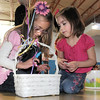 Sisters Breck Petra-Mala, 6, left, and Ellania, 4, choose their prize for completing a game during the preschool Easter Party at the Broomfield Community Center on Thursday.<br /> <br /> April 21, 2011<br /> staff photo/David R. Jennings