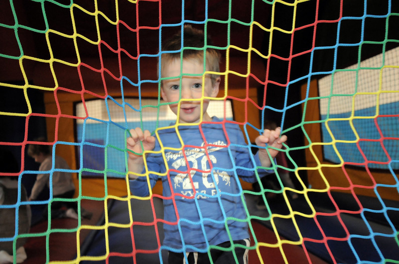 Oliver Zentner, 2, pauses while bouncing in an inflatable during the preschool Easter Party at the Broomfield Community Center on Thursday.<br /> <br /> April 21, 2011<br /> staff photo/David R. Jennings