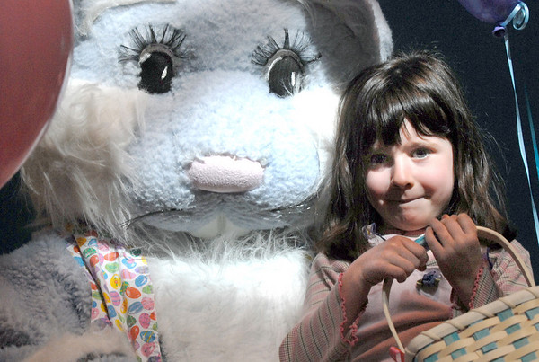 Taylor Portillo, 4, poses for pictures with Flopsy the Bunny during the preschool Easter Party at the Broomfield Community Center on Thursday.<br /> <br /> April 21, 2011<br /> staff photo/David R. Jennings