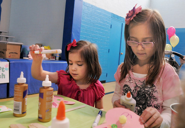 Ellania Petra-Mala, 4, left, and her sister Breck, 6, make bunny crafts during the preschool Easter Party at the Broomfield Community Center on Thursday.<br /> <br /> April 21, 2011<br /> staff photo/David R. Jennings