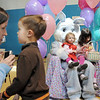 Alana, 2, left, and her sister Taylor Portillo, 4, have their picture taken with Flopsy the Bunny while their cousin Carson Richards, 4, with his mother Erica wait for their turn during the preschool Easter Party at the Broomfield Community Center on Thursday.<br /> <br /> April 21, 2011<br /> staff photo/David R. Jennings