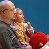 Addisyn Nielson, 1, and her father Chris watch the activities during the preschool Easter Party at the Broomfield Community Center on Thursday.<br /> <br /> April 21, 2011<br /> staff photo/David R. Jennings