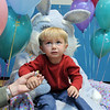 James Sandberg, 2, holding his mother's hand, wasn't sure about being on the lap of Flopsy the Bunny during the preschool Easter Party at the Broomfield Community Center on Thursday.<br /> <br /> April 21, 2011<br /> staff photo/David R. Jennings