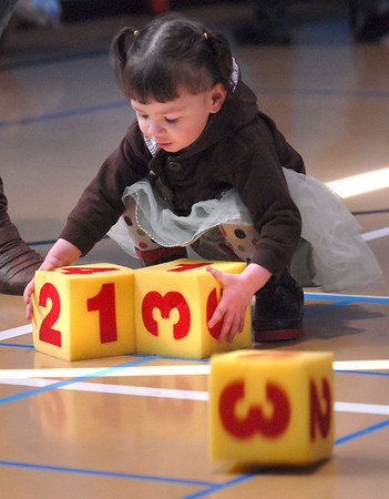 Chloe Veasman, 2, plays with foam blocks during the preschool Easter Party at the Broomfield Community Center on Thursday.<br /> <br /> April 21, 2011<br /> staff photo/David R. Jennings