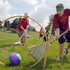 Slytherin's James Ivey, 19, right, scores a goal past Hufflepuff's keeper Nate Fulton, 16, during Mamie Doud Eisenhower Public Library's Quidditch Cup match at Community Center Park on Wednesday.  <br /> July 29,2009<br /> staff photo/David Jennings