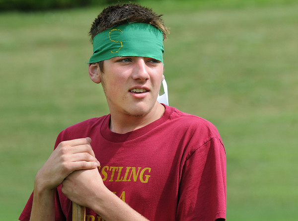 James Ivey, 19, playing for the Slytherin team at Mamie Doud Eisenhower Public Library's Quidditch Cup match at Community Center Park on Wednesday.  <br /> <br /> July 29,2009<br /> staff photo/David Jennings