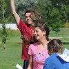 James Ivey, left, pulls the flag from Idalys Spear, 16, winning the game for Slytherin over Griffindor during Mamie Doud Eisenhower Public Library's Quidditch Cup match at Community Center Park on Wednesday.  <br /> July 29,2009<br /> staff photo/David Jennings