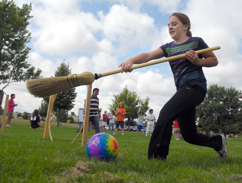 "Kalei Rhodes, 11, stops the ""quaffle"" ball with her broom during Mamie Doud Eisenhower Public Library's Quidditch Cup match at Community Center Park on Wednesday.  <br /> July 29,2009<br /> staff photo/David Jennings"