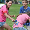 Katie Martinez, 12, left, grabs the snitch flag from Idalys Spear, 16, right, with Tanner Hiebert, 12, blocking during Mamie Doud Eisenhower Public Library's Quidditch Cup match at Community Center Park on Wednesday.  <br /> July 29,2009<br /> staff photo/David Jennings