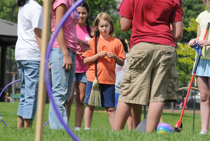 Sophie Lehmann, 10, center, waits for a Quidditch game to begin during Mamie Doud Eisenhower Public Library's Quidditch Cup match at Community Center Park on Wednesday.  <br /> July 29,2009<br /> staff photo/David Jennings