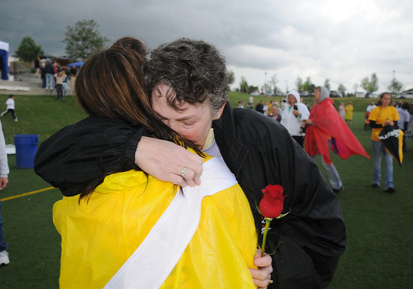Cancer survivors Cindy Chaussart, right, and Brandi Vandegriff hug after the survivor's lap at the 10th Relay for Life Broomfield fundraiser for the American Cancer Society at the Broomfield County Commons on Friday.<br /> <br /> <br /> June11, 2010<br /> Staff photo/David R. Jennings