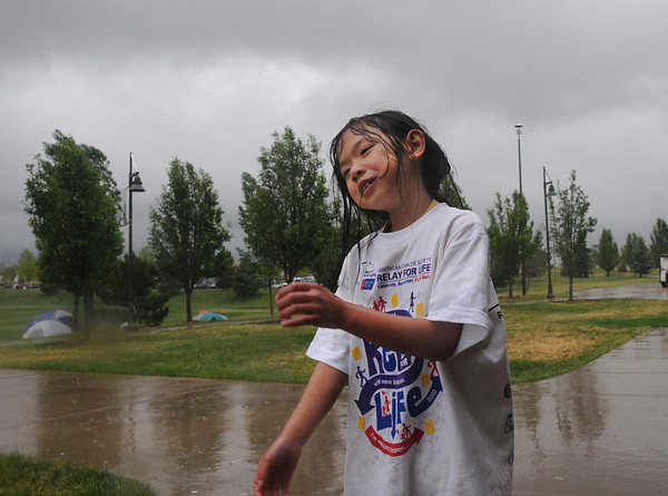 Lea Hibbard, 8, dances in the rain on Friday at the 10th Relay for Life Broomfield fundraiser for the American Cancer Society at the Broomfield County Commons.<br /> <br /> <br /> June11, 2010<br /> Staff photo/David R. Jennings
