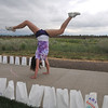 Legacy student Alex Van De Boogaard, 16, does a back flip around the course during the 10th Broomfield Relay for Life at the Broomfield County Commons on Friday.<br /> <br /> June11, 2010<br /> Staff photo/David R. Jennings