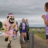 The Legacy High mascot Zeus runs to help cheer on walkers during Friday's 10th Relay for Life Broomfield fundraiser for the American Cancer Society at the Broomfield County Commons.<br /> <br /> <br /> June11, 2010<br /> Staff photo/David R. Jennings