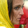 Cancer survivor Brandi Vandegriff smells a rose in contemplation before the survivor's lap on Friday at the 10th Relay for Life Broomfield fundraiser for the American Cancer Society at the Broomfield County Commons.<br /> <br /> <br /> June11, 2010<br /> Staff photo/David R. Jennings