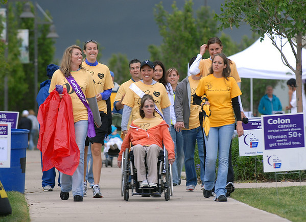 Team members of Brandi and Lucie's Bees walk the course on Friday at the 10th Relay for Life Broomfield fundraiser for the American Cancer Society at the Broomfield County Commons.<br /> <br /> <br /> June11, 2010<br /> Staff photo/David R. Jennings
