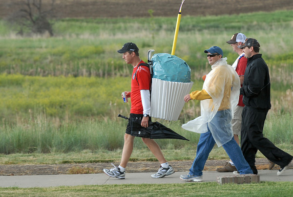 A team carries a big cupcake as they walk on Friday at the 10th Relay for Life Broomfield fundraiser for the American Cancer Society at the Broomfield County Commons.<br /> <br /> <br /> June11, 2010<br /> Staff photo/David R. Jennings