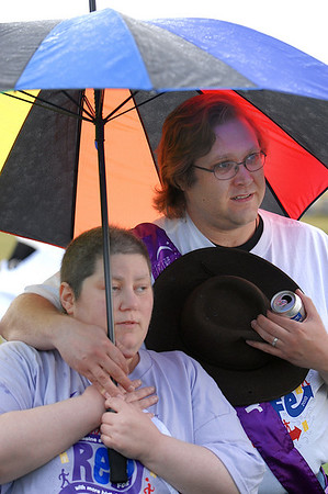Survivor Jennifer Addis and caregiver John Newton listen to Friday's opening ceremonies of the 10th Relay for Life Broomfield fundraiser for the American Cancer Society at the Broomfield County Commons.<br /> <br /> <br /> June11, 2010<br /> Staff photo/David R. Jennings