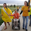 Brandi Vandegriff, left , and her sister Chelsea Vandegriff, right, help pull Desirae Gettman up the hill as they walk the course on Friday at the 10th Relay for Life Broomfield fundraiser for the American Cancer Society at the Broomfield County Commons.<br /> <br /> <br /> June11, 2010<br /> Staff photo/David R. Jennings