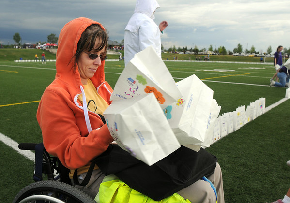Desirae Gettman helps set up luminarias around the championship field for Friday's 10th Relay for Life Broomfield fundraiser for the American Cancer Society at the Broomfield County Commons.<br /> <br /> <br /> <br /> June11, 2010<br /> Staff photo/David R. Jennings