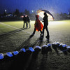 Walkers carry umbrellas as they go past the luminarias  during Friday's 10th Relay for Life Broomfield fundraiser for the American Cancer Society at the Broomfield County Commons.<br /> <br /> June11, 2010<br /> Staff photo/David R. Jennings