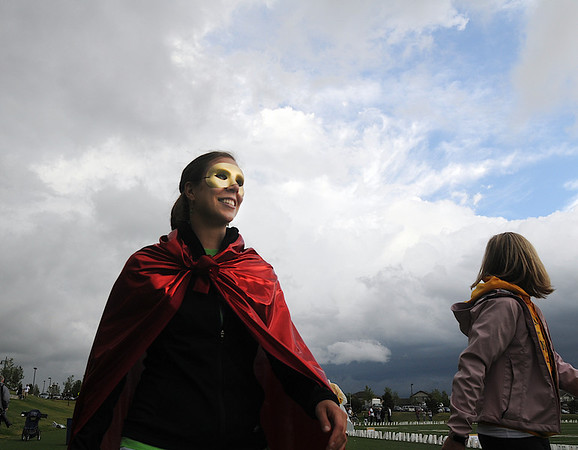 Kristen Acevedo walks for the Rock Creek Caped Crusaders on Friday at the 10th Relay for Life Broomfield fundraiser for the American Cancer Society at the Broomfield County Commons.<br /> <br /> <br /> June11, 2010<br /> Staff photo/David R. Jennings