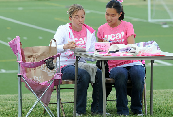 Kayla Wobschall, 15, left, and Lillian Cardwell, 15, make luminarias for Friday's 10th Relay for Life Broomfield fundraiser for the American Cancer Society at the Broomfield County Commons.<br /> <br /> <br /> June11, 2010<br /> Staff photo/David R. Jennings