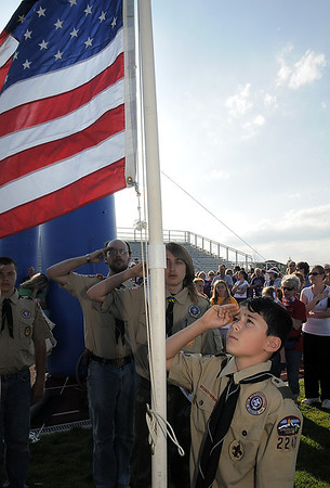 Ricky Hermisillo salutes after Boy Scout Troop 2247 raises the flag during the opening ceremonies of the Broomfield Relay for Life at Holy Family High School on Saturday.<br /> June 10, 2011<br /> staff photo/David R. Jennings