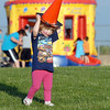 Mia Schroeder, 2 wears an orange cone as a hat during the Broomfield Relay for Life at Holy Family High School on Saturday.<br /> June 10, 2011<br /> staff photo/David R. Jennings