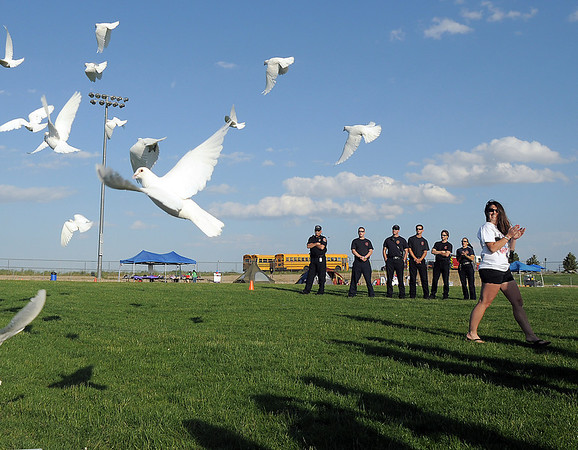 White pigeons are released at the start of the Broomfield Relay for Life at Holy Family High School on Saturday.<br /> June 10, 2011<br /> staff photo/David R. Jennings