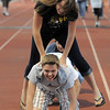 Abbie Chapman leap frogs over Trent Koch as they goes around the track during the Broomfield Relay for Life at Holy Family High School on Saturday.<br /> June 10, 2011<br /> staff photo/David R. Jennings