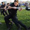 North Metro Fire Rescue firefighter Alan Anderson pulls during the fire vs. police tug of war at the Broomfield Relay for Life at Holy Family High School on Saturday.<br /> June 10, 2011<br /> staff photo/David R. Jennings