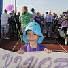 Cancer survivor Addison Kleinhans, 6, helps carry the survivor's banner during the survivor's lap at Broomfield Relay for Life at Holy Family High School on Saturday.<br /> June 10, 2011<br /> staff photo/David R. Jennings