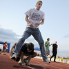 Lance Woodland leap frogs over Eric Spangler as they go around the track during the Broomfield Relay for Life at Holy Family High School on Saturday.<br /> June 10, 2011<br /> staff photo/David R. Jennings