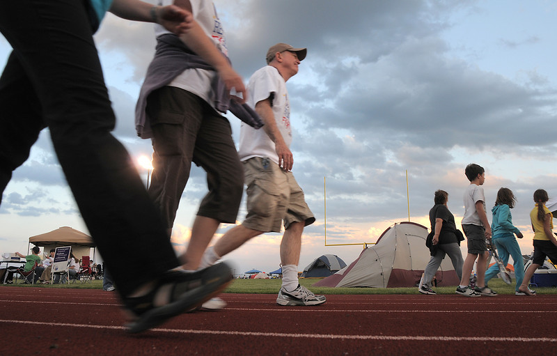 Walkers travel around the track during the Broomfield Relay for Life at Holy Family High School on Saturday.<br /> June 10, 2011<br /> staff photo/David R. Jennings