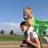 Rebecca Lassen carries her daughter Ava, 1 1/2, on her shoulders as they walk around the track during the Broomfield Relay for Life at Holy Family High School on Saturday.<br /> June 10, 2011<br /> staff photo/David R. Jennings