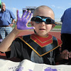 Cancer survivor Logan Moore, 4 1/2, shows his inked hand after placing his hand print on a banner for cancer survivors during the Broomfield Relay for Life at Holy Family High School on Saturday.<br /> June 10, 2011<br /> staff photo/David R. Jennings