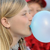 Corinne Lassen, 12, blows a big bubble of chewing gum during the Broomfield Relay for Life at Holy Family High School on Saturday.<br /> June 10, 2011<br /> staff photo/David R. Jennings