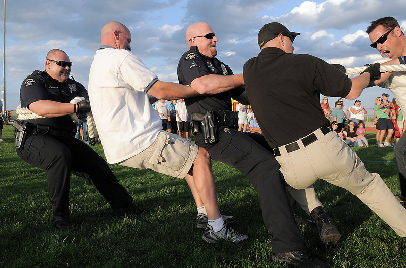 The Broomfield Police tug of war team's winning pull during the fire vs. police tug of war at the Broomfield Relay for Life at Holy Family High School on Saturday.<br /> June 10, 2011<br /> staff photo/David R. Jennings